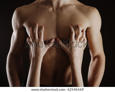 Close up of woman caressing  her man's chest - stock photo