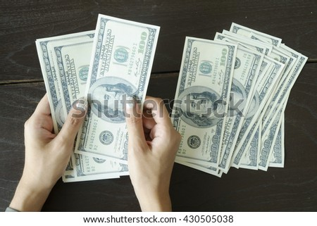 close up of woman counting money at home , savings, finances, economy as concept
