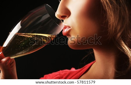 close-up of woman drinking champagne - stock photo