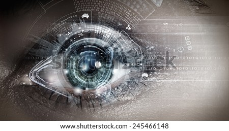 Close up of woman eye in process of scanning - stock photo
