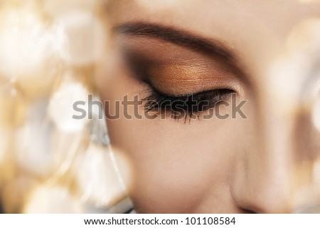 Close up of woman face with eye makeup