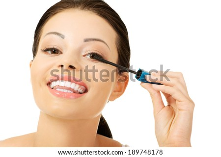 Close up of woman face with mascara brush  - stock photo