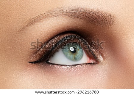 Close-up of woman green eye with beautiful arabic make-up. Oriental makeup