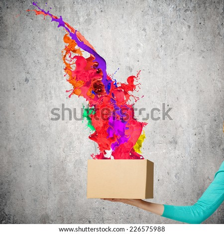 Close up of woman hand holding carton box - stock photo