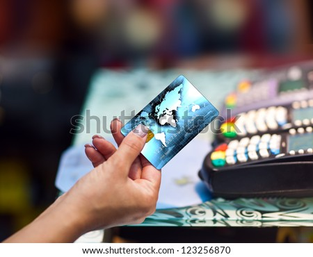 close up of woman hand holding credit card - stock photo