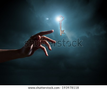 Close up of woman hand holding golden key - stock photo