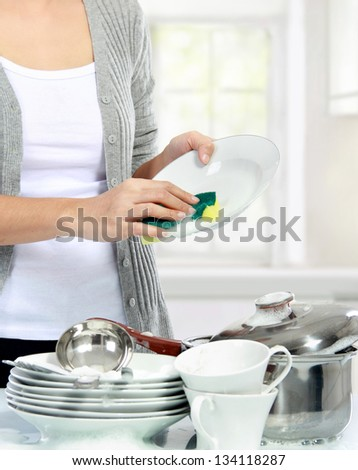 close up of Woman hand Washing Dishes in the kitchen