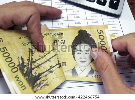 Close up of woman hands counting korean money. business finance concept - stock photo