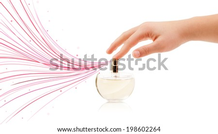 close up of woman hands spraying colorful lines from beautiful perfume bottle