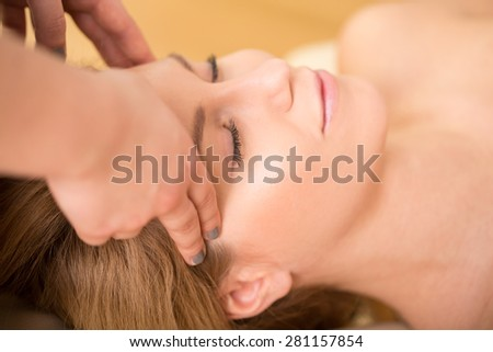 Close-up of woman having bioenergy therapy