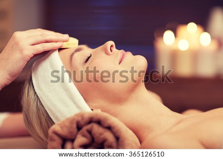 close up of woman having face cleaning in spa