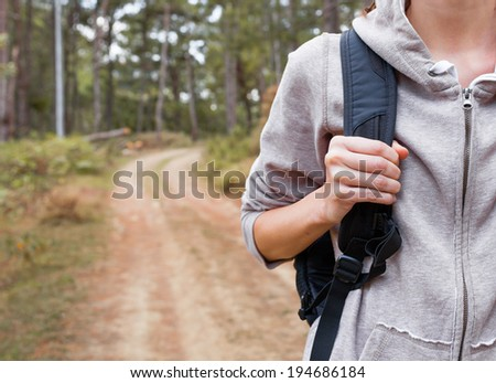Close up of woman hiker walking on a rural road. - stock photo