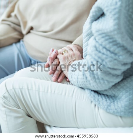 Close up of woman holding aged female hand