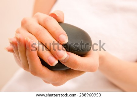 Close-up of woman holding stones - stock photo