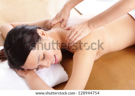 close up of Woman in beauty salon having massage of shoulder, asian woman model - stock photo