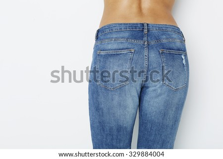 Close up of woman in tight blue jeans