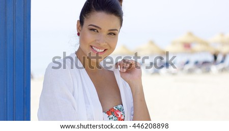 Close up of woman near surfboards - stock photo