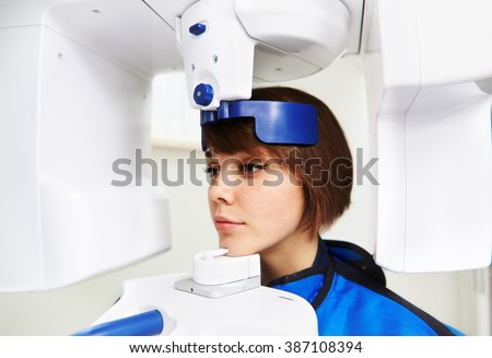 Close-up of woman patient doing panoramic teeth x-ray in dental clinic. Concept of medical technology and equipment.  - stock photo