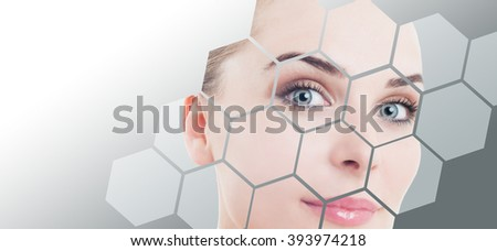 Close-up of woman perfect face with beauty correction and makeup against gray background gradient - stock photo