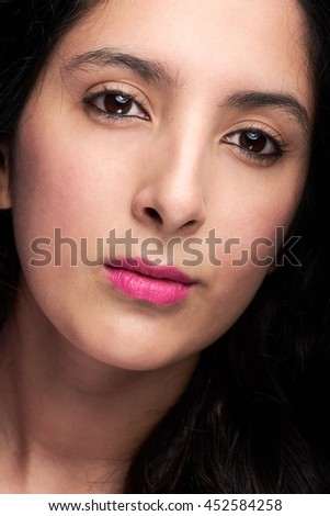 close up of woman pretty face isolated on black