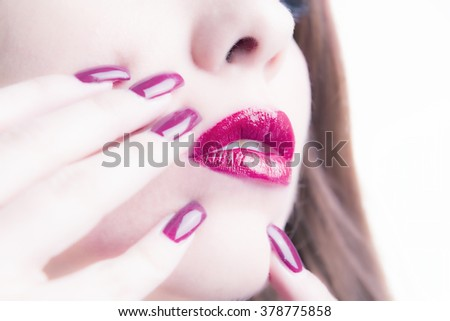 Close-up Of Woman's Face With Red Lipstick And Shiny Nail Varnish