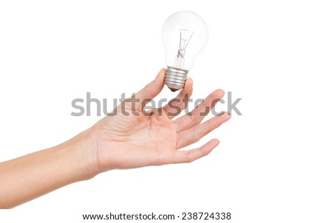 Close up of woman's hand holding light bulb. Studio shot isolated on white. - stock photo