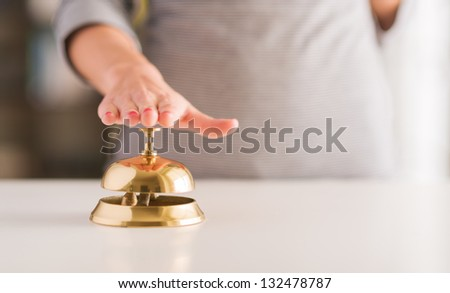 Close-up Of Woman's Hand Ringing Service Bell