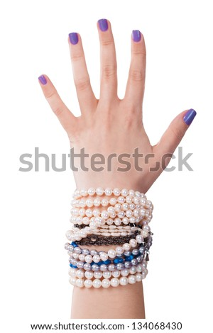 Close-up Of Woman's Hand With Pearl Bracelet Isolated On White Background - stock photo