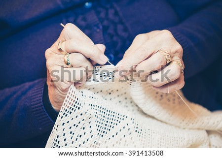 Close-up of woman's hands crocheting - stock photo
