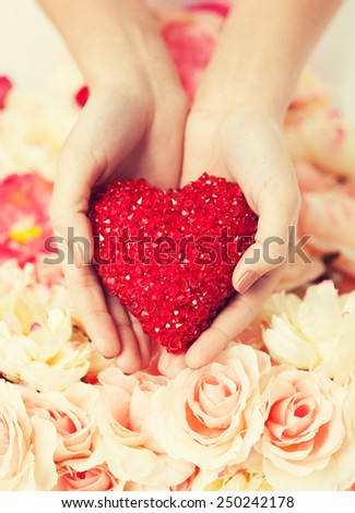 close up of woman's hands holding heart - stock photo