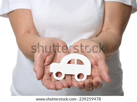 Close up of woman's hands holding model car isolated on white background - stock photo