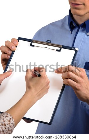 Close up of woman's hands receiving post and signing document. - stock photo