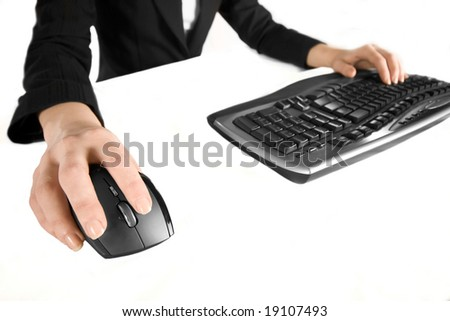 Close up of woman's hands using keyboard and mouse