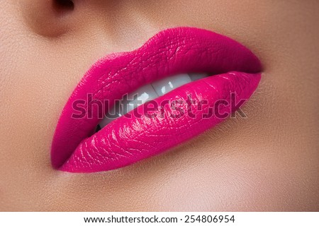 Close-up of Woman's Lips with Bright Fashion Pink Lips. Macro Lilac Lipstick Make-up - stock photo