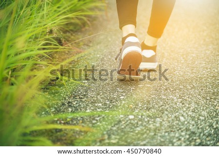 Close up of woman's shoes hiking in the mountains - stock photo