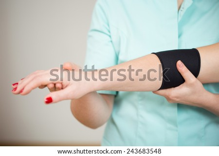 Close-up of woman's sick arm with protective band