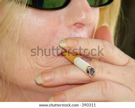 Close up of Woman Smoking - stock photo