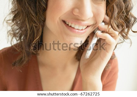 Close up of woman talking on mobile phone - stock photo