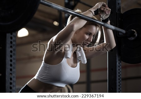 Close-up of woman training at crossfit center - stock photo