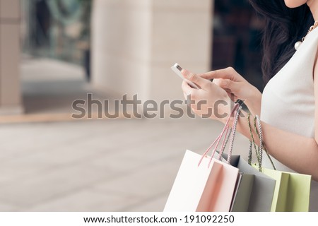Close-up of woman using her smartphone - stock photo