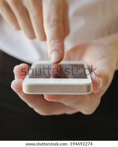 Close up of woman using mobile phone. - stock photo