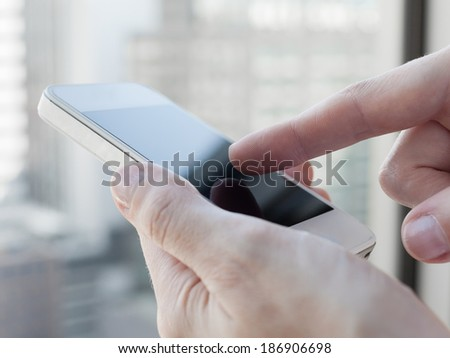 Close up of woman using mobile smart phone. - stock photo