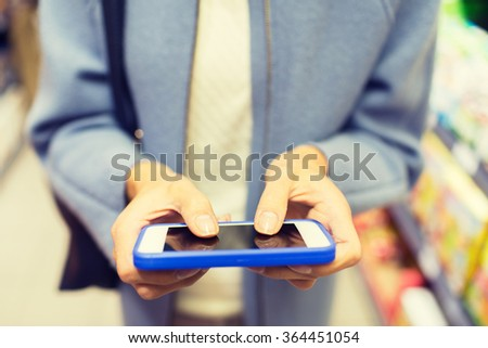 close up of woman with smartphone in market - stock photo