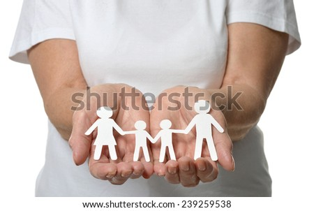 Close up of womans hands showing paper family