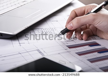 Close-up of women�s hands doing paperwork - stock photo