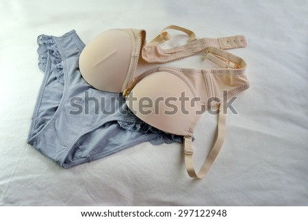 Close up of women's panties and bra isolated on white background, selective focus. - stock photo