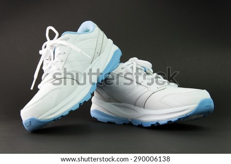 Close up of women's sport shoes on white background - stock photo