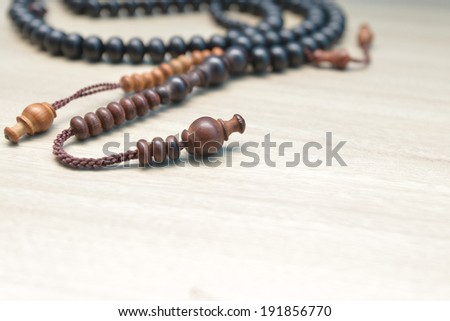 close up of wood tasbih - stock photo