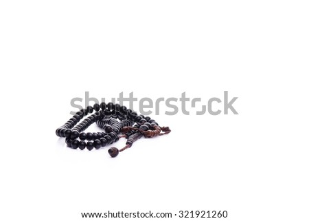 close up of wood tasbih. Wooden rosary with isolated white - stock photo