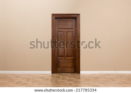 Close up of wooden door in the empty room with copy space - stock photo